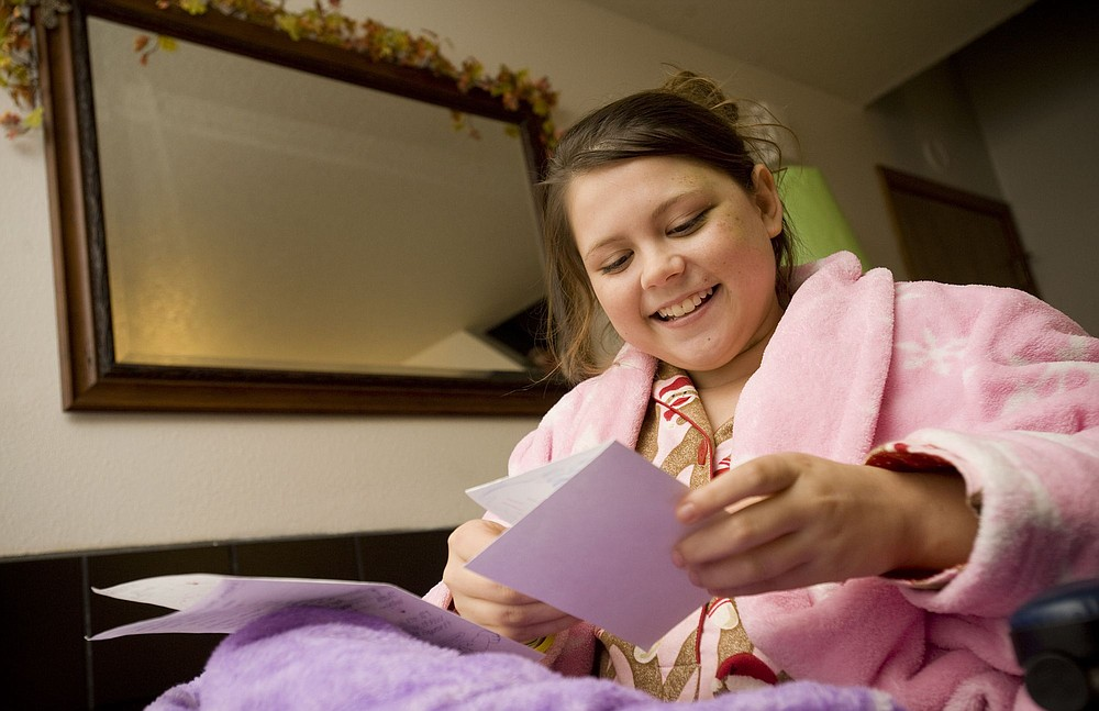 STEVEN LANE/The Columbian Mallorie Broussard reads a card made by  classmates Tuesday, the