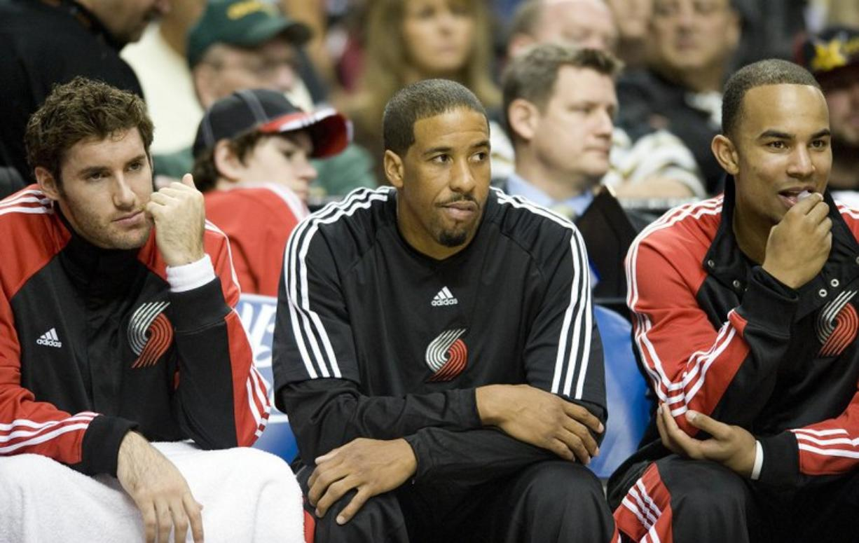 Steven Lane/The Columbian Andre Miller, center, became vocal about his reserve role on the Blazers earlier this season. But now there's no point in battling the decision of his head coach.