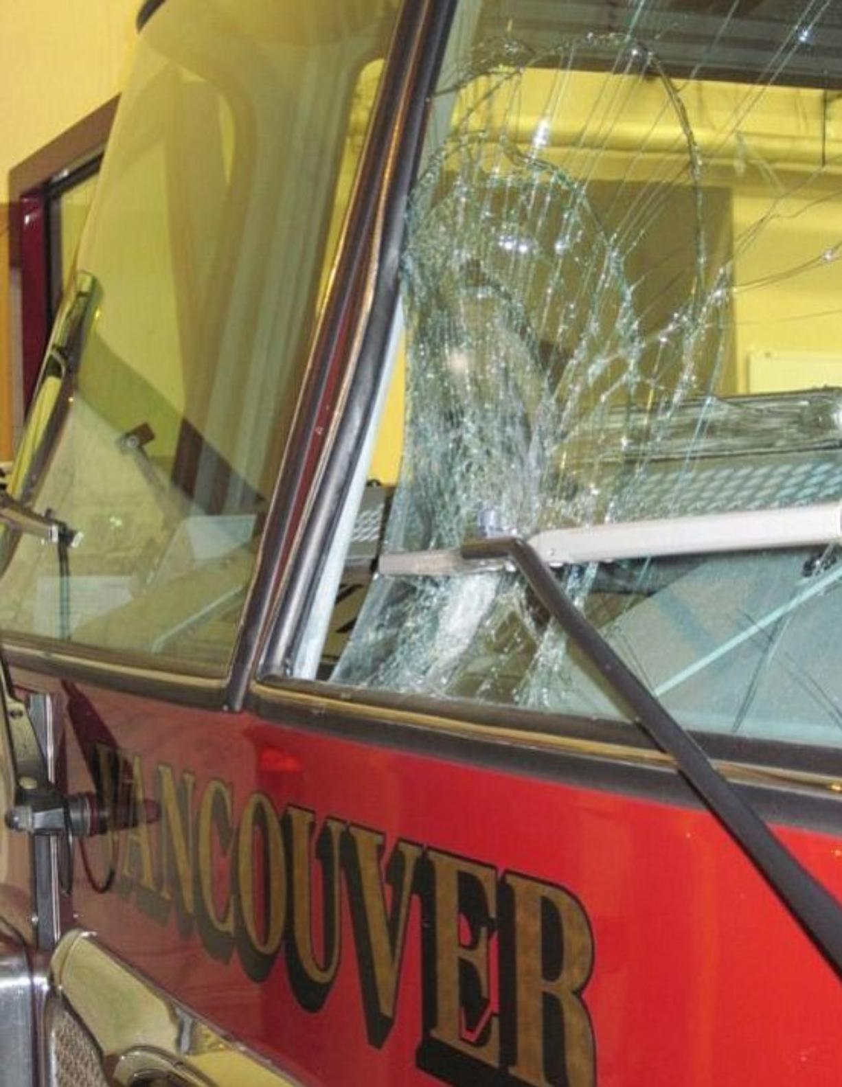Shane Parker/Vancouver Fire Department A large rock caved in part of the windshield of one of the Vancouver Fire Department's ladder trucks early Saturday.