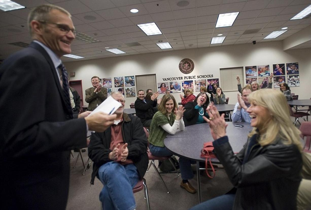 Vancouver Public Schools Superintendent Steve Webb, left, announces levy results on Tuesday to a crowd of administrators and boosters gathered in a conference room.