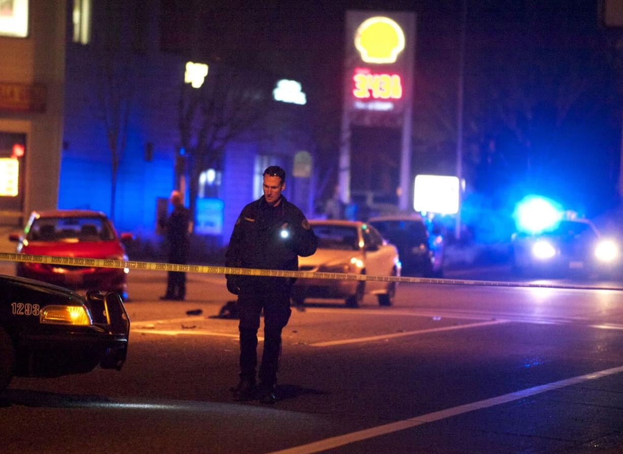 Police investigate a fatal collision at Northeast Vancouver Mall Drive and 72nd Avenue that killed two women, both mothers, who were walking in the crosswalk on Jan. 19, 2014.