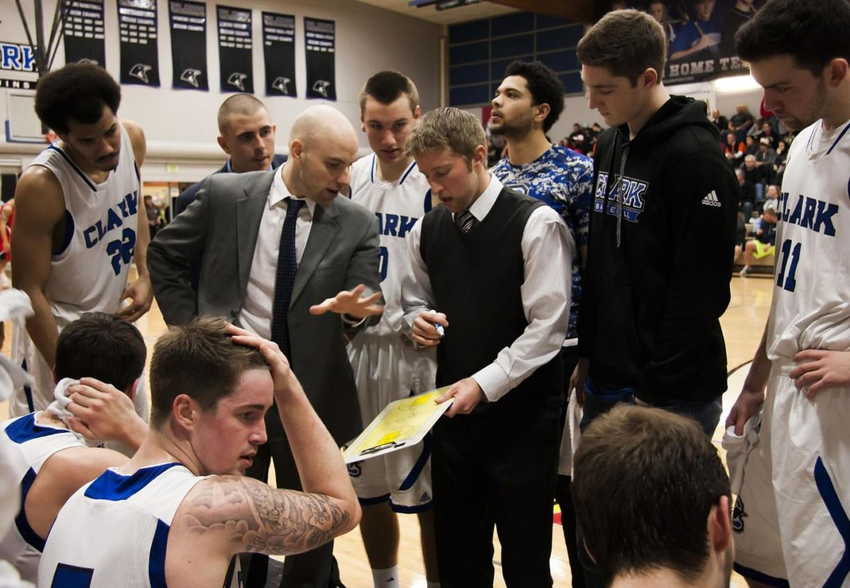 The Clark College men's basketball team huddles during a timeout against Lower Columbia College on Feb. 7.