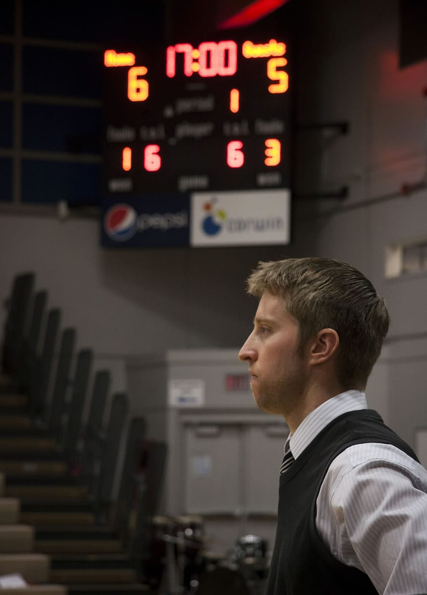 Head coach Alex Kirk watches his team take on Lower Columbia on Feb. 7. Kirk is in his third year as head coach at Clark.
