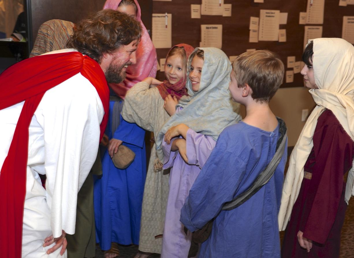 """Mark Dahl, who plays Jesus in """"Bow the Knee,"""" visits with some of the children in the musical during a dress rehearsal Sunday at Liberty Bible Church of the Nazarene in Salmon Creek. The Passion play -- an enactment of the crucifixion of Christ -- will be in a larger venue, Crossroads Community Church in Vancouver, and run March 19-22."""