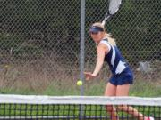 Sammi Hampton returns a shot while competing for Skyview High School in the spring.