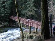Lacamas Lake Regional Park visitors access the footbridge across Lower Falls on Lacamas Creek in this 2012 photo.