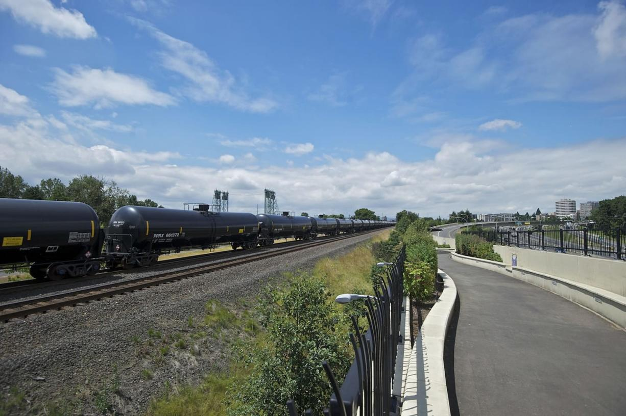 An oil train passes the Vancouver Land Bridge in  June 2014.