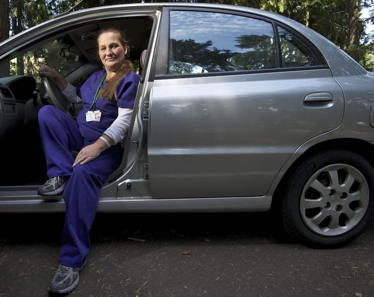 Jenny Rund, an itinerant Certified Nursing Assistant and personal caregiver, shows off her shiny new-to-her Kia Rio. A program called Ways To Work, operated by Metropolitan Family Service in Portland and brought north via a grant from the Community Foundation for Southwest Washington, aims to help low-income families get to school and work via financial education and affordable car loans.