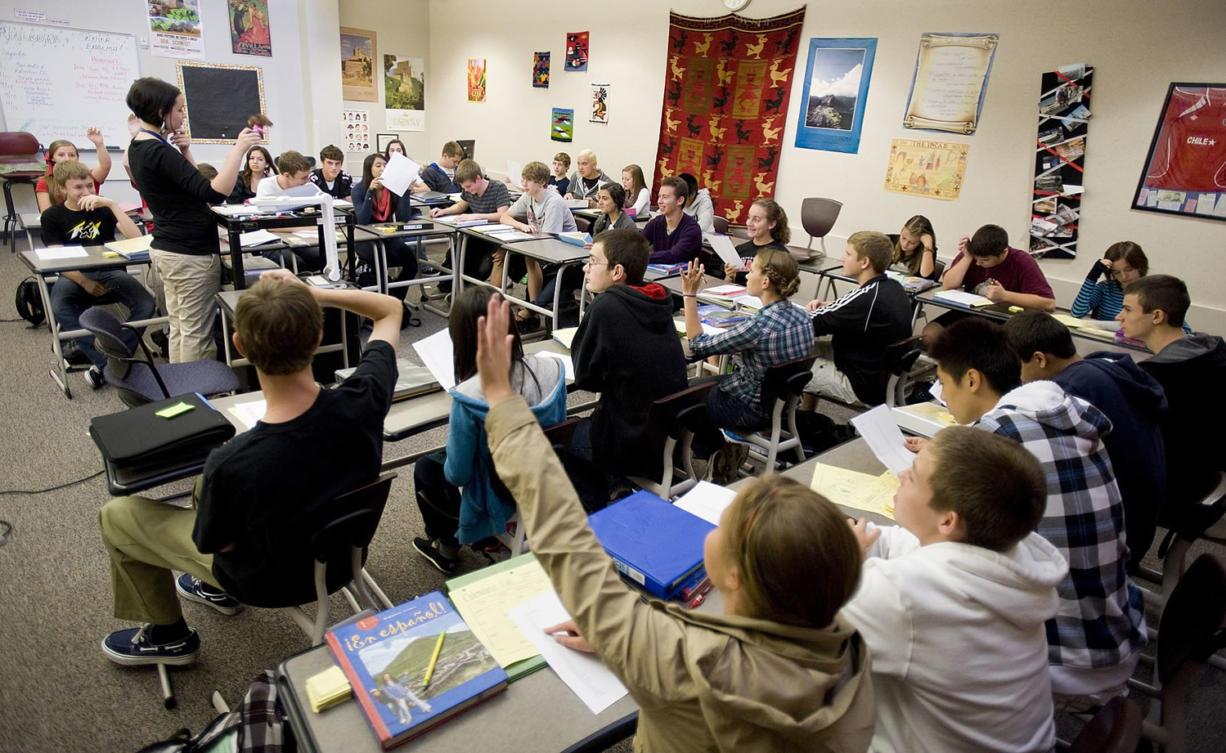 Jamie Rodda teaches Spanish 1 to a full classroom at Camas High School in 2011.