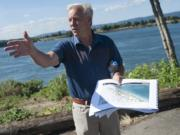 Barry Cain, president of Tualatin-based Gramor Development, leads a group on a tour of the Vancouver waterfront in July.