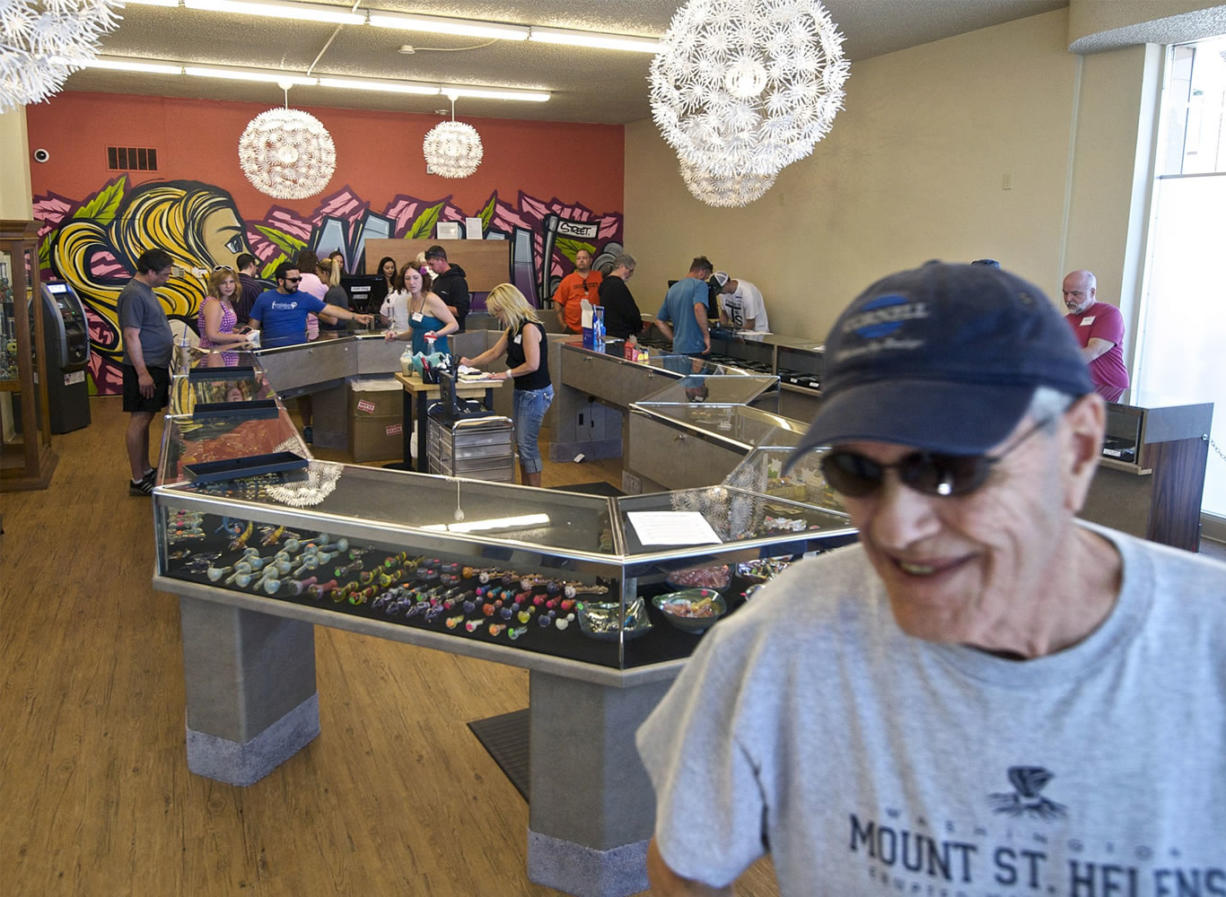 Medical marijuana user Krae Williams, 71, walks out of Main Street Marijuana after buying weed from the shop July 28.