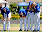 Cascade Little League players Mathew Chudek, Lucas Horowitz, Jake Bowen and Ben Jones show their disappointment after losing to Idaho 8-7 on an a aiding a player call to end the game in the bottom of the 6th inning Friday August 14, 2015 at the Little League Western Regionals in San Bernardino, Calif.