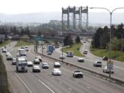 Traffic moves along I-5 near the Interstate Bridge, seen from the Evergreen Boulevard overpass.