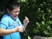 Ariane Kunze/The Columbian files Carlos Fuerte, 10, gets a surprise spray in the face at the Esther Short Park fountain on a 101-degree day in July. This summer may break a record for days with high temperatures exceeding 90 degrees, but unlike Portland, our record streak is longer.