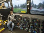 Student james West rides a bus to Yacolt Monday March 23, 2015. The No. 47 bus between Battle Ground and Yacolt, one of C-Tran's least-used routes.