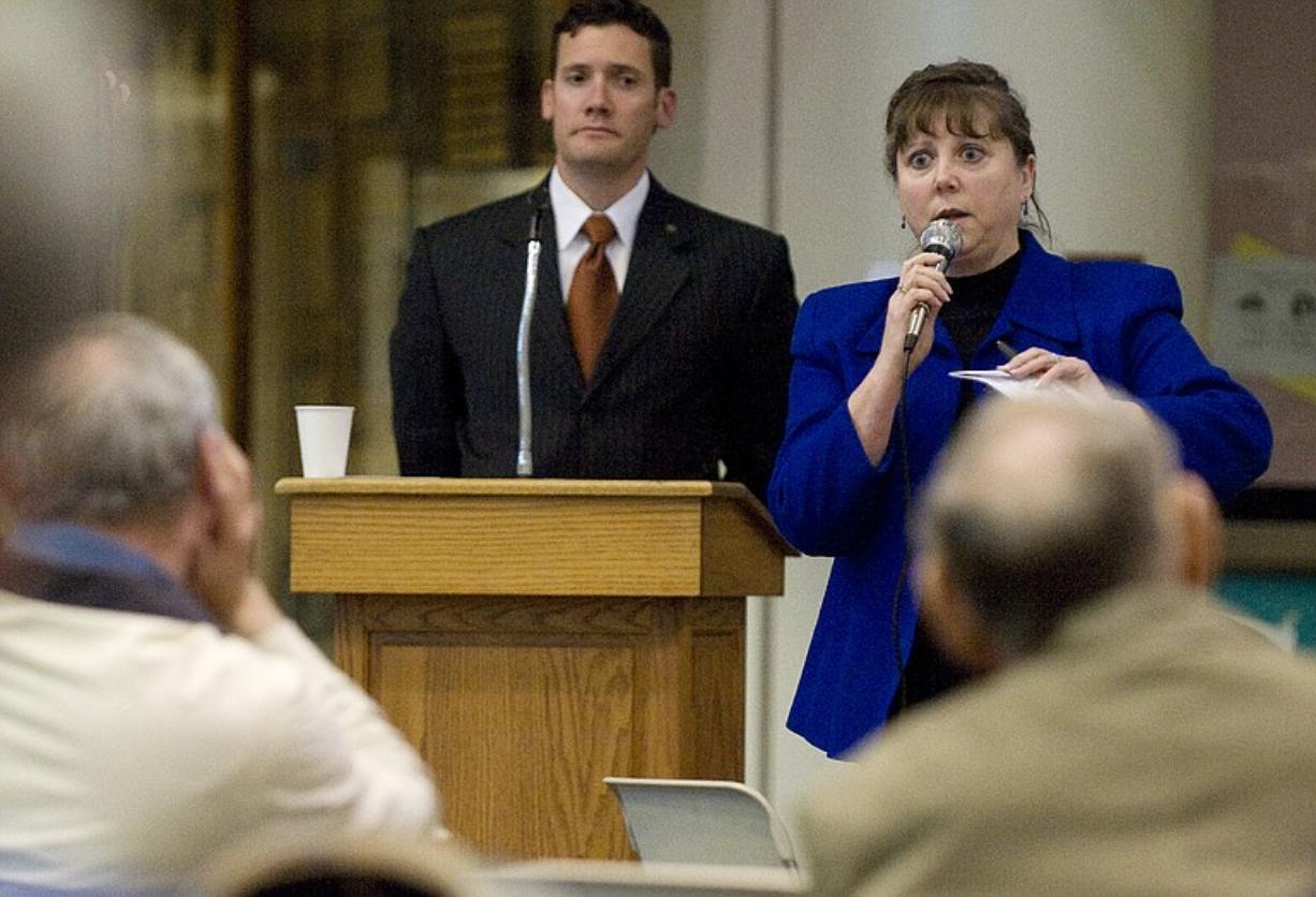 Vancouver City Council member Jeanne Harris, right, speaks at a town hall meeting in April.