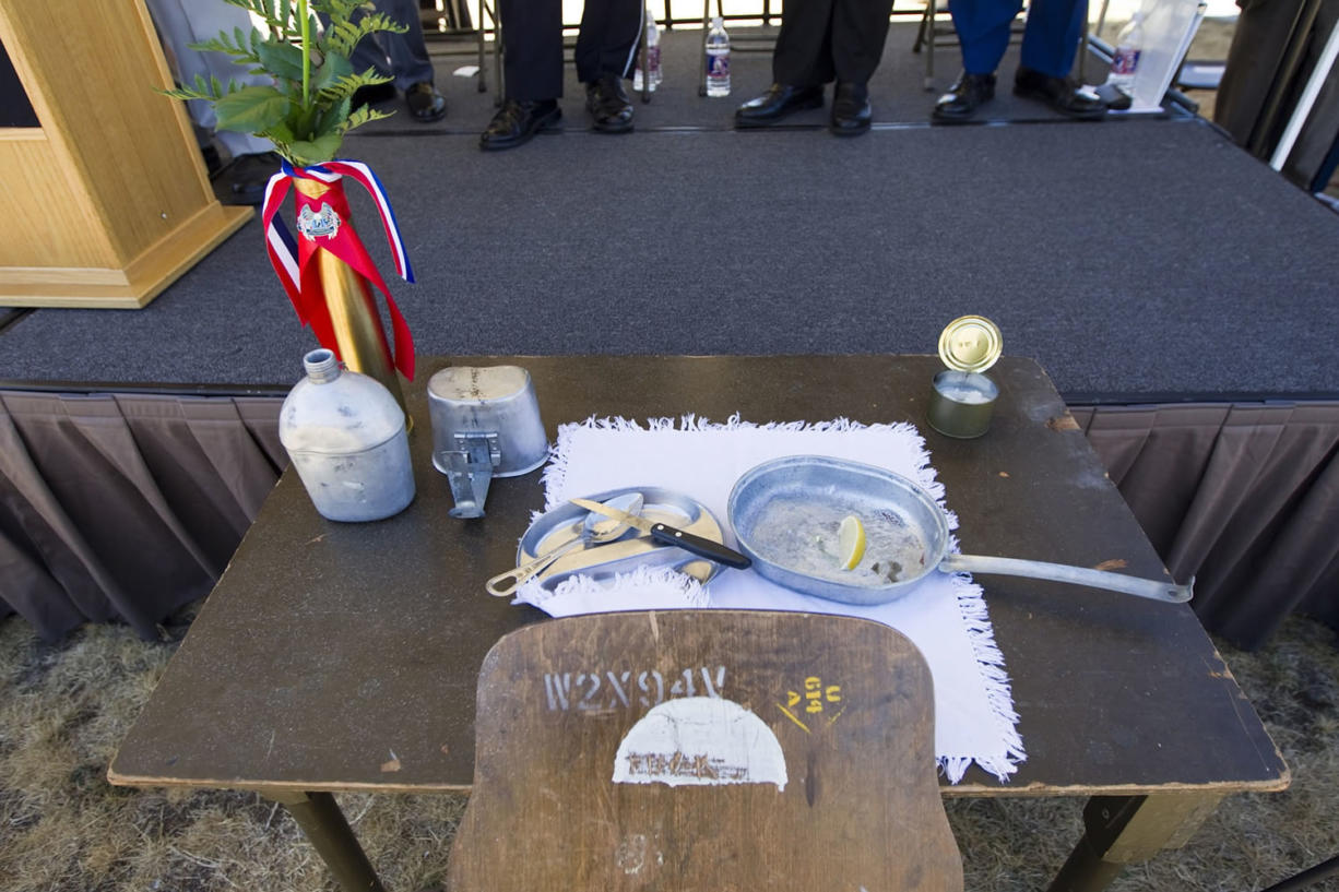 A table is set for one to symbolize POW and MIA soldiers at the dedication of a new POW/MIA memorial at the Armed Forces Reserve Center in Vancouver Saturday September 20 2014.