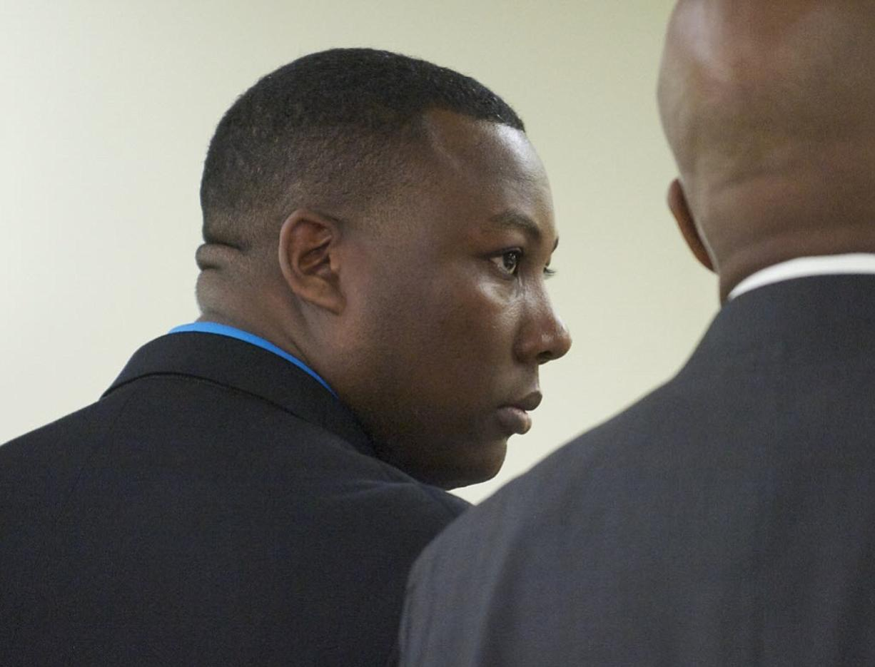 Former Beaverton police Officer Christopher Warren appears in Clark County Superior Court June 6, 2013, in connection with a child rape charge.