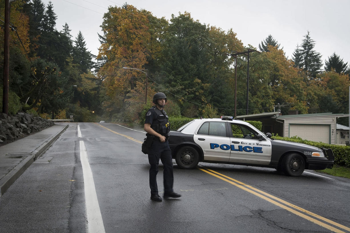 Police block off East Evergreen Boulevard near North Blandford Drive on Oct. 31 to contain shooting suspect John Kendall.