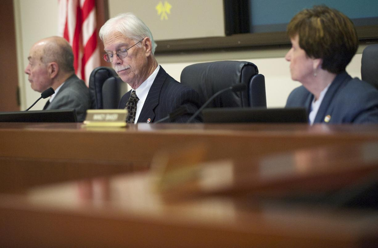 The Port of Vancouver commissioners, from left, Jerry Oliver, Brian Wolfe and Nancy Baker meet on Oct. 28.