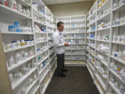 Pharmacist Patrick Gallaher works inside The Vancouver Clinic at Columbia Tech Center.