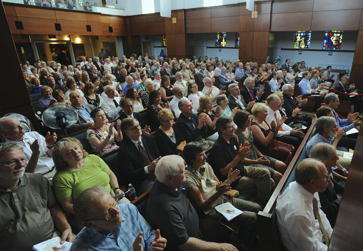 Hundreds of people packed into the sanctuary and nearby overflow rooms Sunday at First United Methodist Church to celebrate the life of philanthropist Ed Lynch.