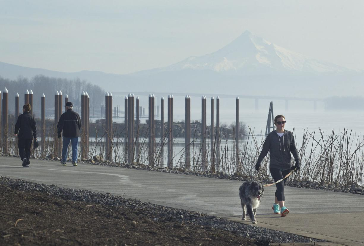 Briana McCartney walks with her dog, Gaia, along Vancouver's Waterfront Renaissance Trail, which reopened Friday after repairs to two sections damaged by high river flows in 2011 were completed.
