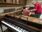 Don Mitchell works with student Stefan Kincaid, 25, of Sennett, N.Y.