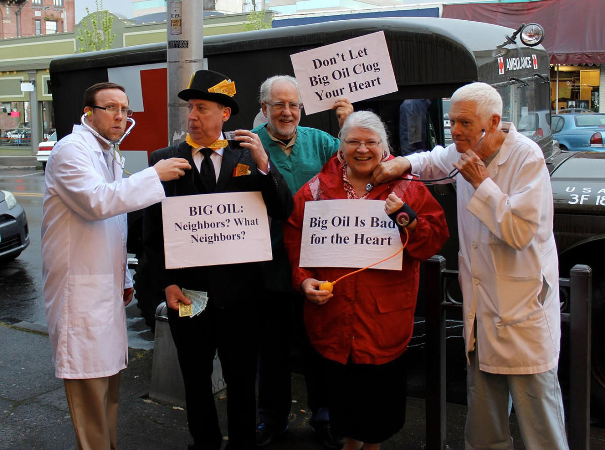 Courtesy photo He's not a doctor, but he played one on Main Street. In April, the Rev. Brooks Berndt, left, and some members of his congregation brought anti-oil-train guerilla theater to downtown Vancouver.