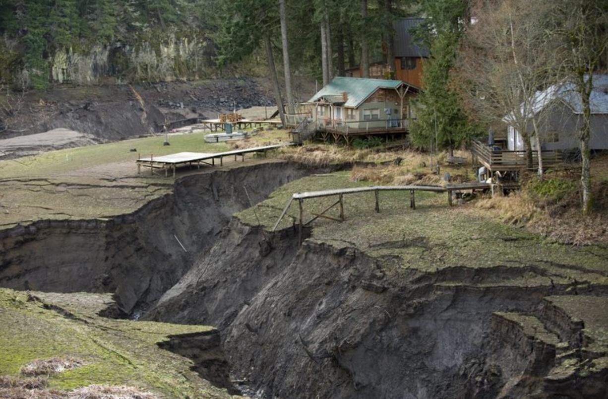 Cabins along what used to be Northwestern Lake are threatened by erosion as the White Salmon River cuts a new path to the Columbia River after Condit Dam was breached.
