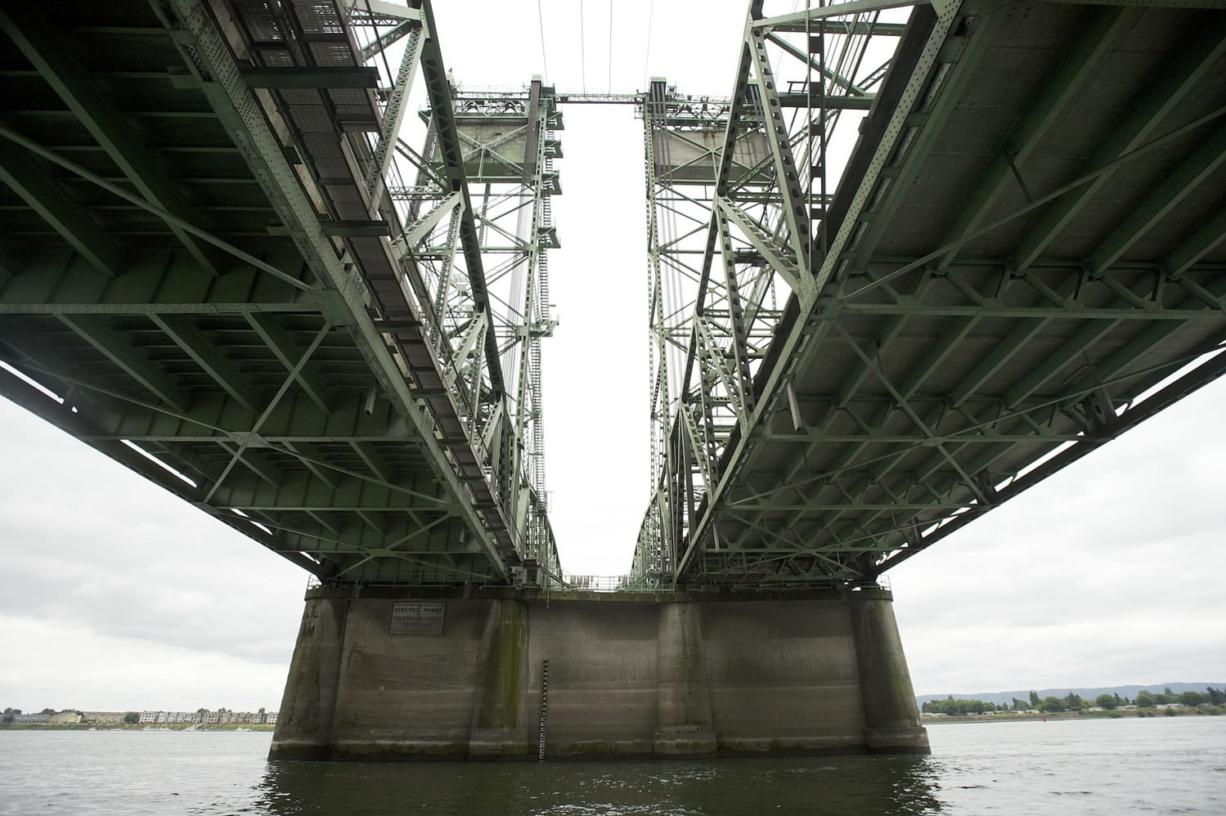 The current Interstate 5 Bridge, seen here looking toward the Oregon shore from under the lift span, is actually two bridges. The upstream bridge is older.