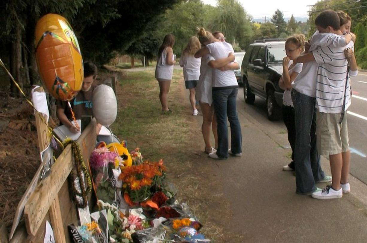 Students from Hudson's Bay High School mourn in September 2009 at a memorial set up on St.