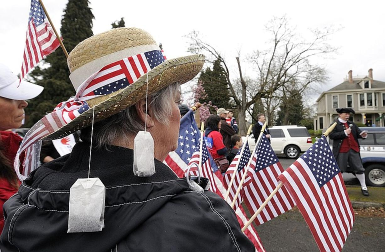 Shari Parsons of Vancouver wore a straw hat adorned with tea bags when she attended a protest rally against health care reform Tuesday outside the Vancouver office of U.S. Rep.