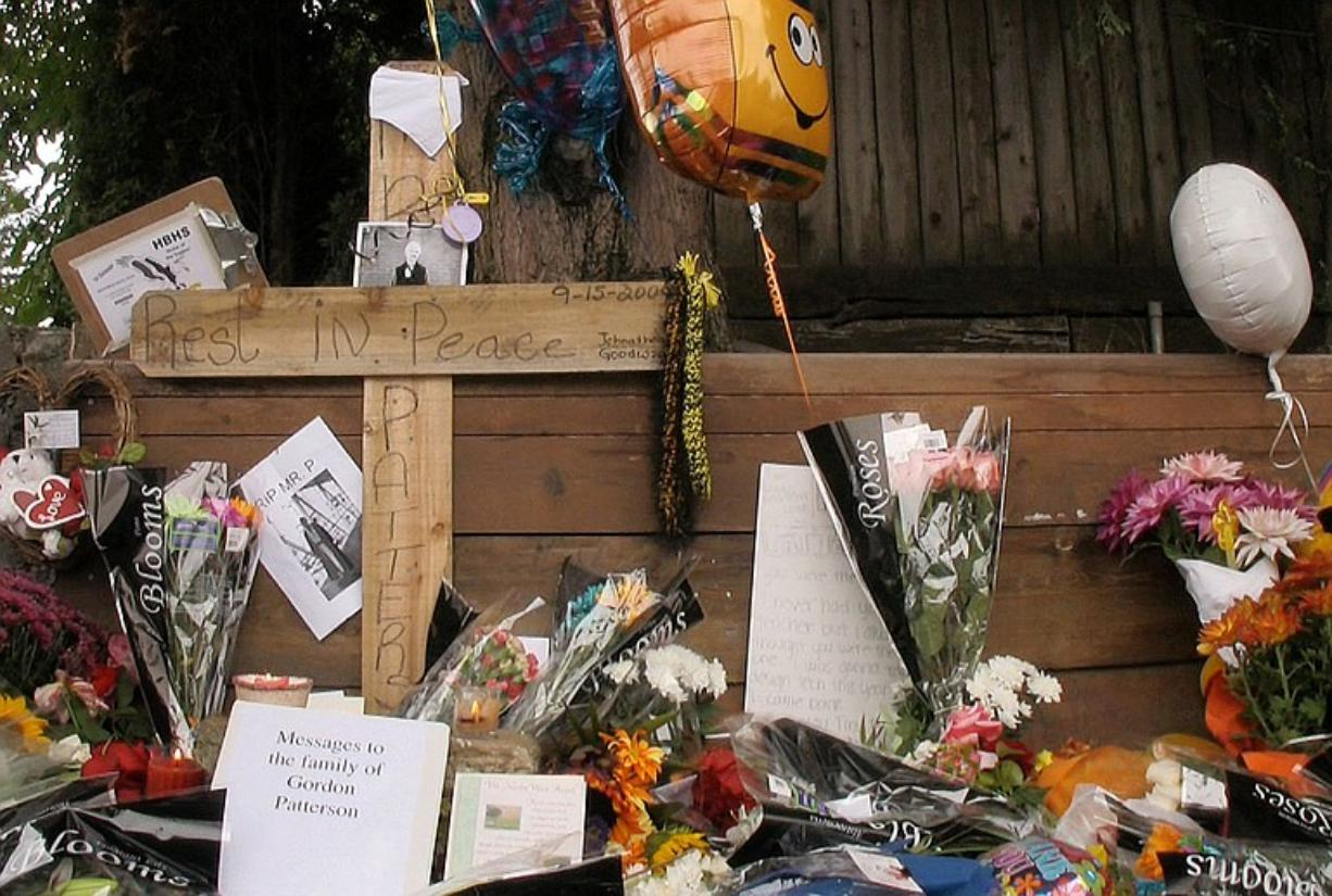Flowers, cards and mementos were left near the site where Hudson's Bay teacher Gordon Patterson was killed while riding his bicycle on Sept.