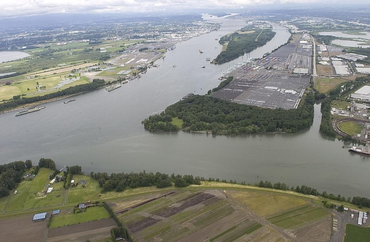 """The Columbia River flows past the confluence of the Willamette River in this aerial view on Friday. """"One of the great natural jewels of the Pacific Northwest is making a comeback, but we have a long way to go,"""" Oregon Gov."""