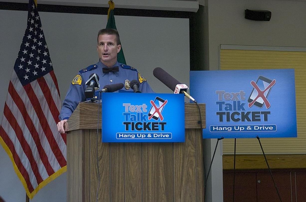 Washington State Patrol Capt. Chris Gundermann at a Monday press conference introduces a revised law designed to strengthen an existing law prohibiting talking or texting on cell phones while driving.