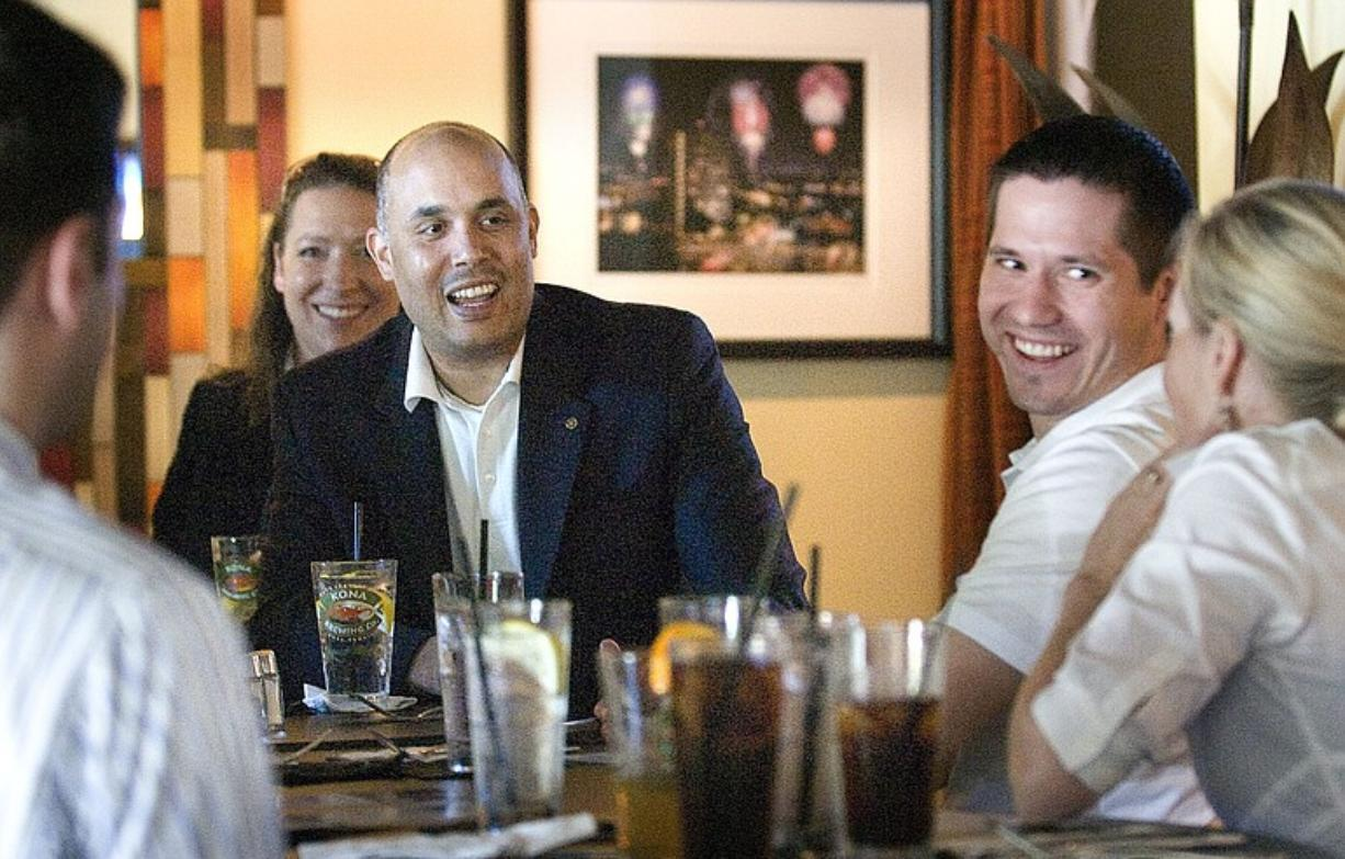 Republican David Castillo, a candidate for the open 3rd Congressional District seat, fields questions from lawyers, bankers, Realtors and other young professionals over lunch June 18 at Tommy O's Bistro in downtown Vancouver.