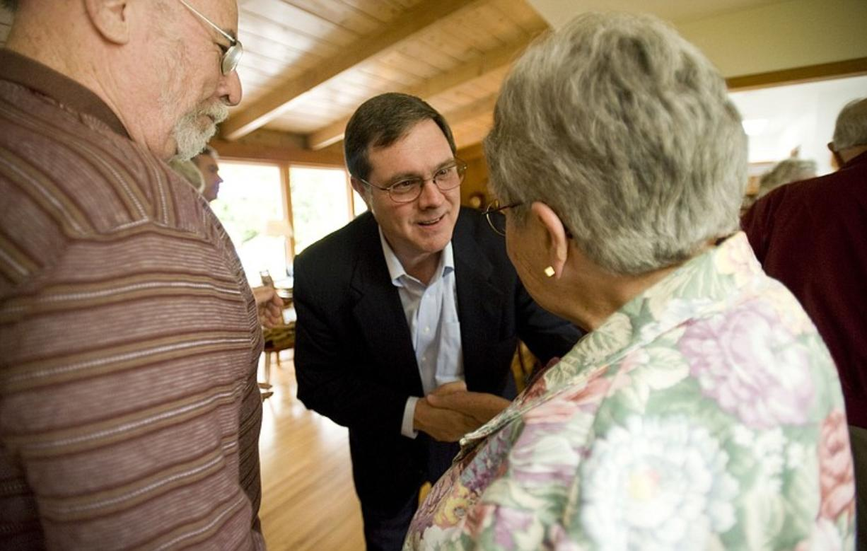 Denny Heck greets Mac and Pat Echols, who now live in the Vancouver house where he grew up, during a Lake Shore neighborhood campaign event in early June.