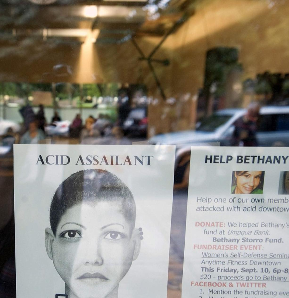 A flier depicting an alleged assailant in an acid attack -- now revealed as a fake -- hung in the window of Anytime Fitness in downtown Vancouver on Sept.