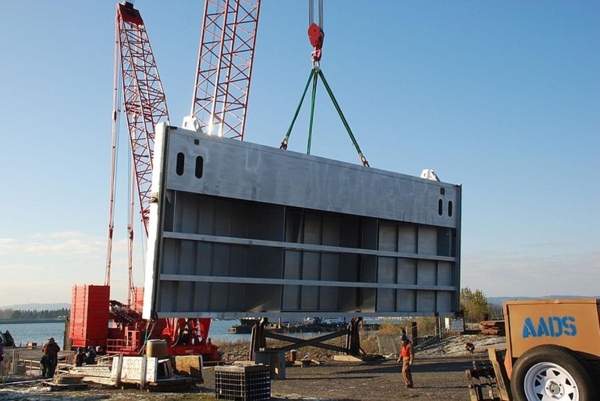 Crews load the final section of the new John Day navigation lock downstream gate at the east slip of the Columbia Business Center in Vancouver.