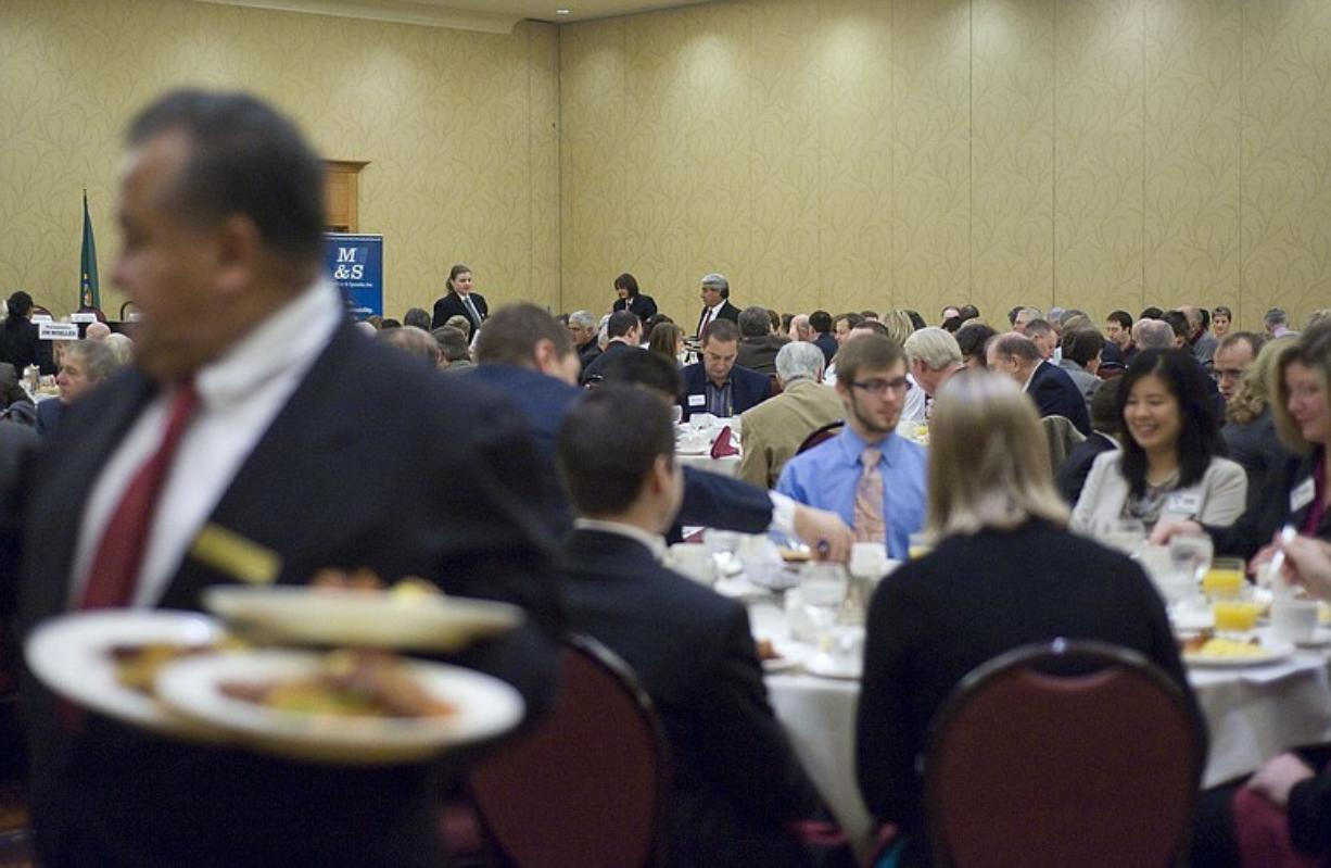 State lawmakers, local officials and business leaders share a meal during the annual legislative breakfast at the Hilton Vancouver Washington on Friday.