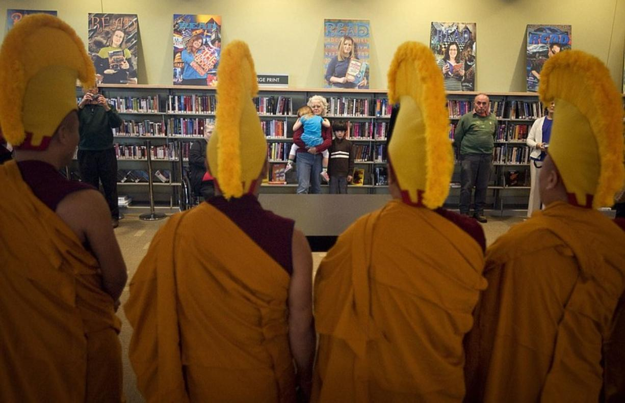 Monks from Drepung Loseling Phukhang Monastery wear orange and red because their culture considers those colors the humblest and least attractive, according to translator Tenzin Sherab of Gresham, Ore.