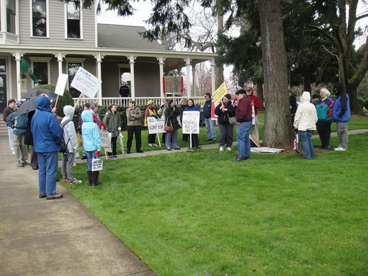 MoveOn.org supporters and counter-protesters rally Thursday outside the office of U.S. Rep. Jaime Herrera Beutler, R-Camas, at the O.O. Howard House. She met with some MoveOn members privately in east Vancouver.
