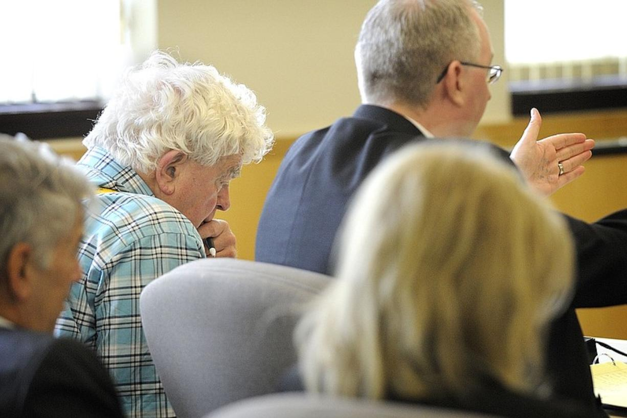 Richard Morse, 72, in plaid shirt, listens to his attorney, Jim Senescu, right, ask a witness questions during the opening day of his guardianship trial in Clark County Superior Court Judge Diane Woolard's courtroom on Monday. A jury Friday ruled Morse needs a guardian.