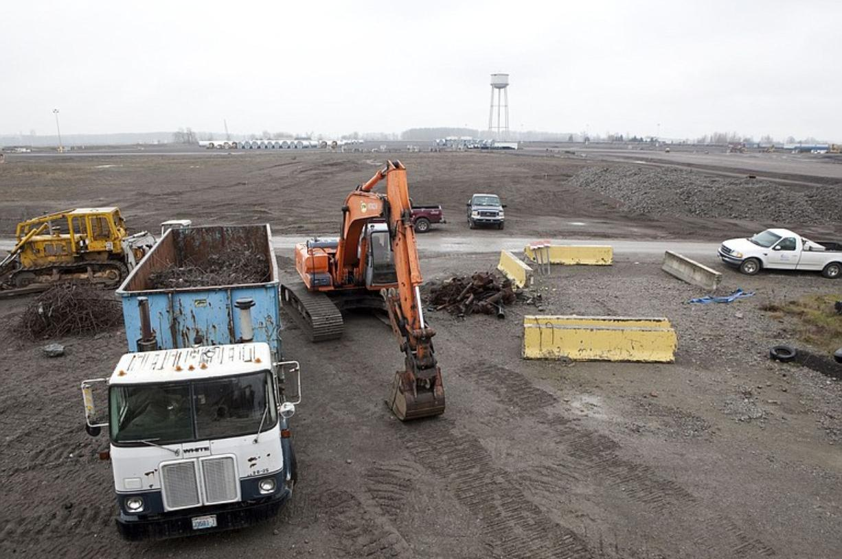 Crews at the Port of Vancouver's Terminal 5 move rocks and gravel to prepare the area to store wind energy components.
