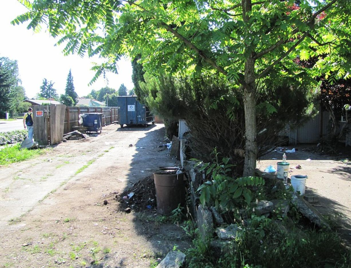 A cleanup has begun at this Sifton foreclosure home where squatters accumulated garbage for years.