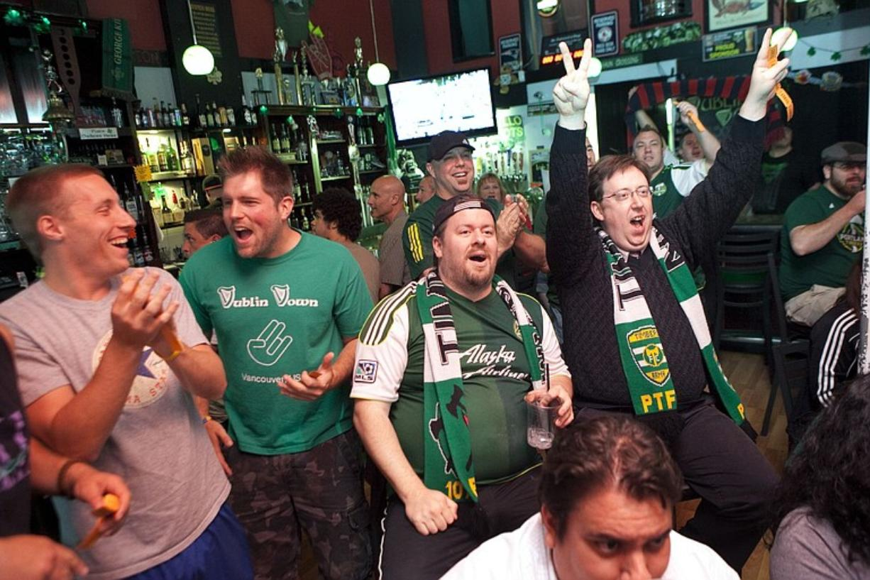 (From left) Zack Melnick, Kevin Lengvenis, Jon Lincicum and Brent Diskin -- part of the Timbers Army -- react to a play while watching a recent Timbers game at the Dublin Down Irish Pub in downtown Vancouver.
