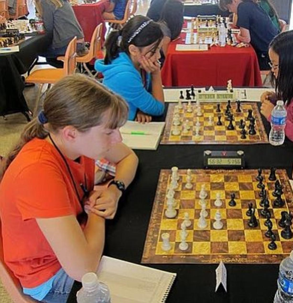 Heather Young, left, plays in the 2011 Susan Polgar International Championship, where she placed 18th.