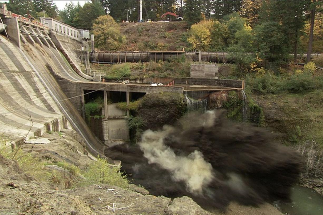 A remote video camera captures the force of a massive explosion as it breaches Condit Dam shortly after noon Wednesday, releasing the White Salmon River for the first time since the dam was built in 1913.