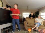 Marty Embleton, right, chats with her grandsons, Nick, left, and Alex Embleton at their home in Vancouver.